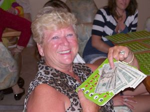 Mary Lou Fans Out Her Jackpot