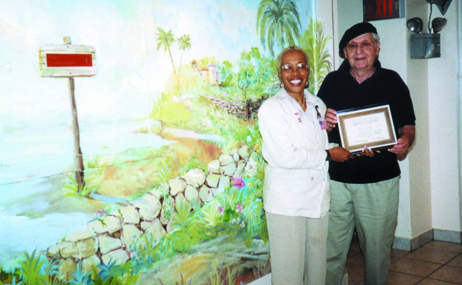Dott Nicholson-Brown presenting award to Pablo Verol for Mediterranean Mural